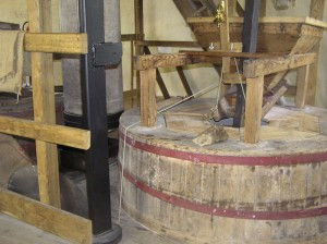 The milling set up, as normally seen during a visit to the mill, with the stones enclosed by wooden casings and hoppers