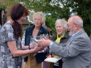 Sue Colclough receiving the Margaret Bonsall Art Challenge Trophy from judge Bryan Bonsall with Freda Stallerbrass and fellow judge Doreen Andrews looking on