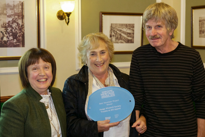 Angela, Lynn and Alan with the windmill's award